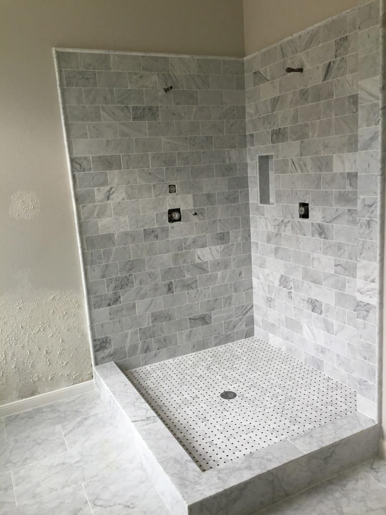 """Minimalist Modern Carrara Bianca Bathroom remodel in Austin Tx"