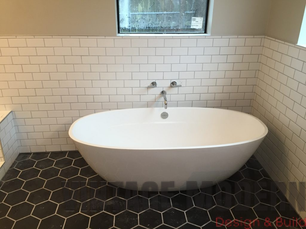 This bathroom remodeling project in austin tx was done by vintage modern design build