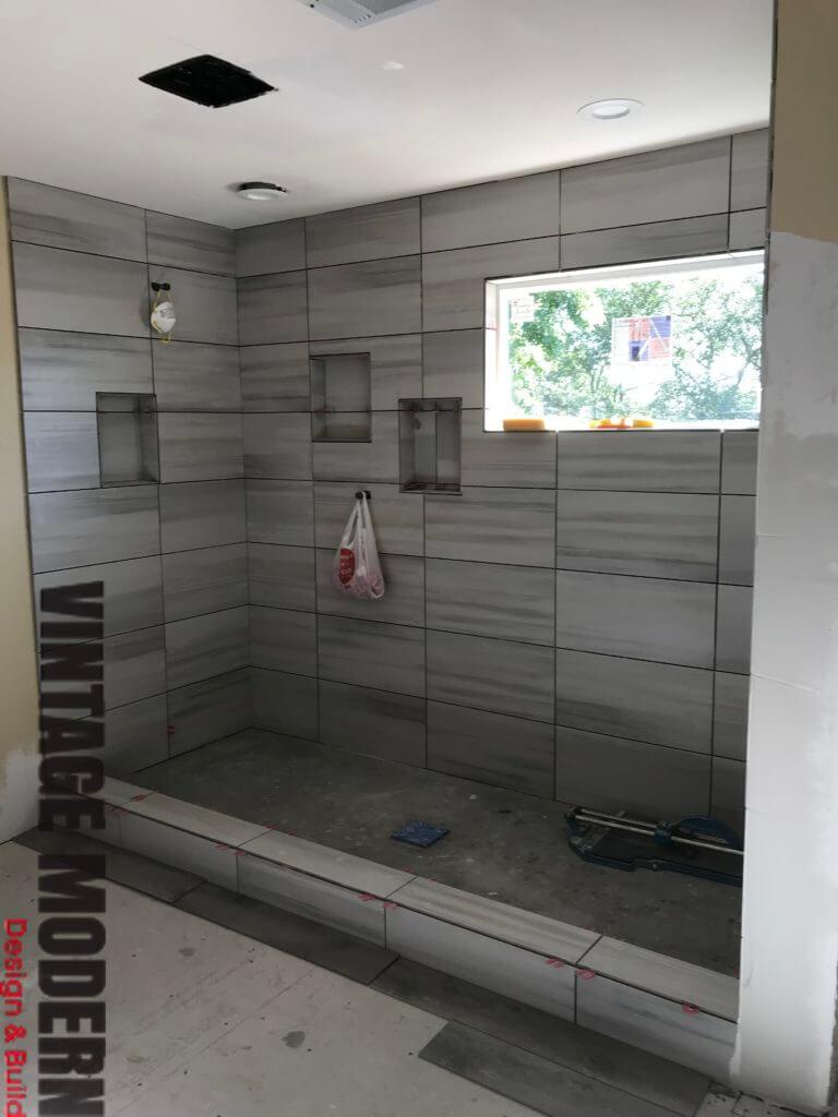 Minimalist modern bathroom remodel tile contractor Austin TX